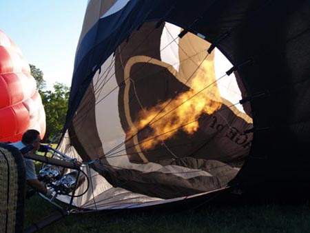 filling the balloon with hot air